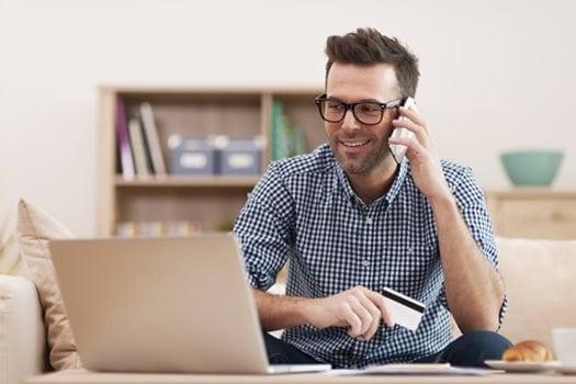 Smiling-man-making-order-by-mobile-phone_Medium-(1)
