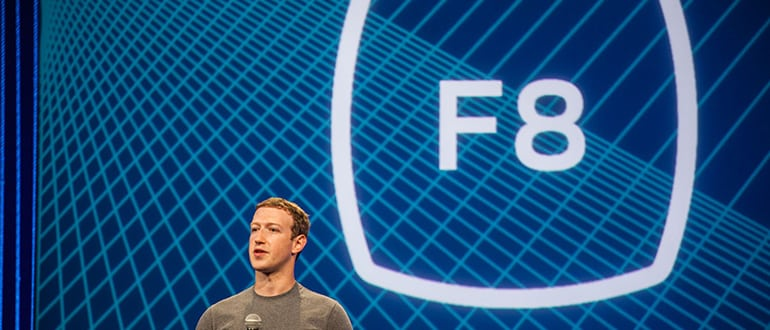 Mark Zuckerberg in front of a large F8 screen